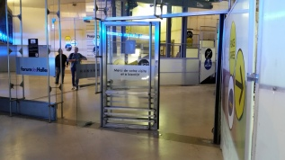Doors opened both ways and sometimes jammed closed, reducing pedestrian flow.